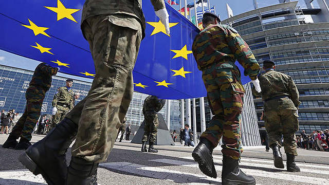 Soldiers in Brussels carrying EU flag