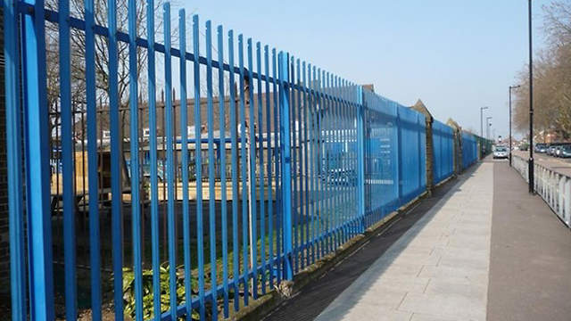 Completed metal security fence on a commercial lot