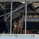 Sri Lankan police stand at the site of an explosion in a restaurant area of the luxury Shangri-La Hotel in Colombo,