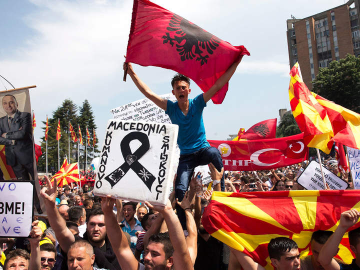 Protesters in Skopje wave Albanian and Turkish flags along Macedonian in protests against government. Photo: Fatos Bytyci / The Independent