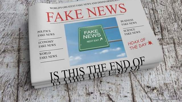 Fake News headlines in a newspaper