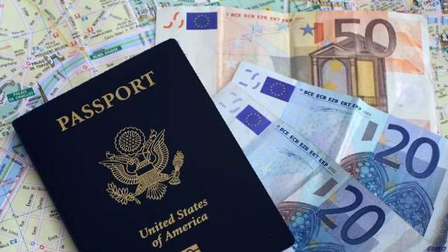 The US passport and euros on a map